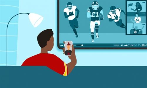 Man enjoying a football watch party with a friend on his phone