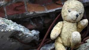 toy bear suffering from burns